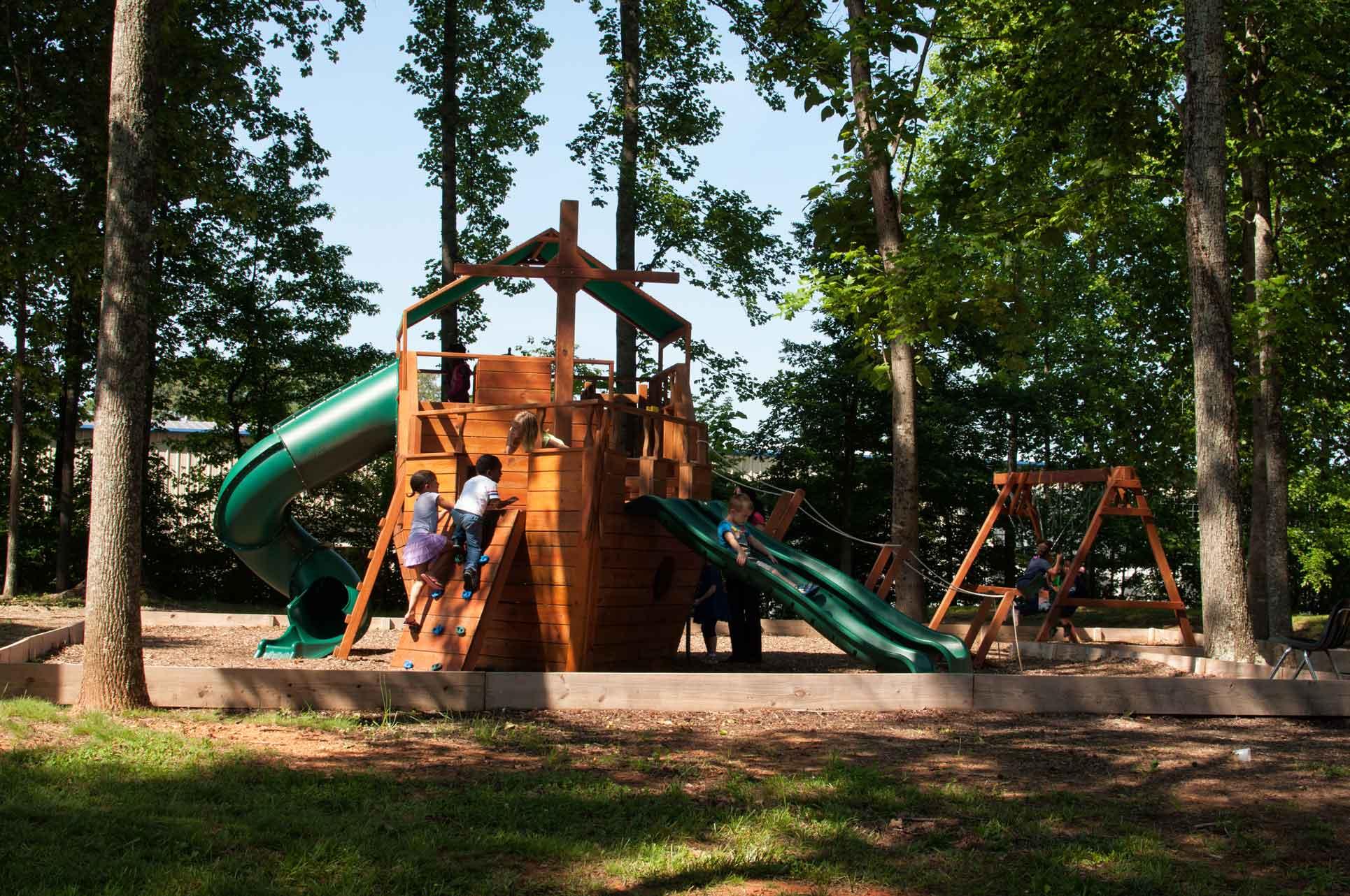 Burlington-Private-Elementary-School-Students-Climbing-Ladder-on-Playground-