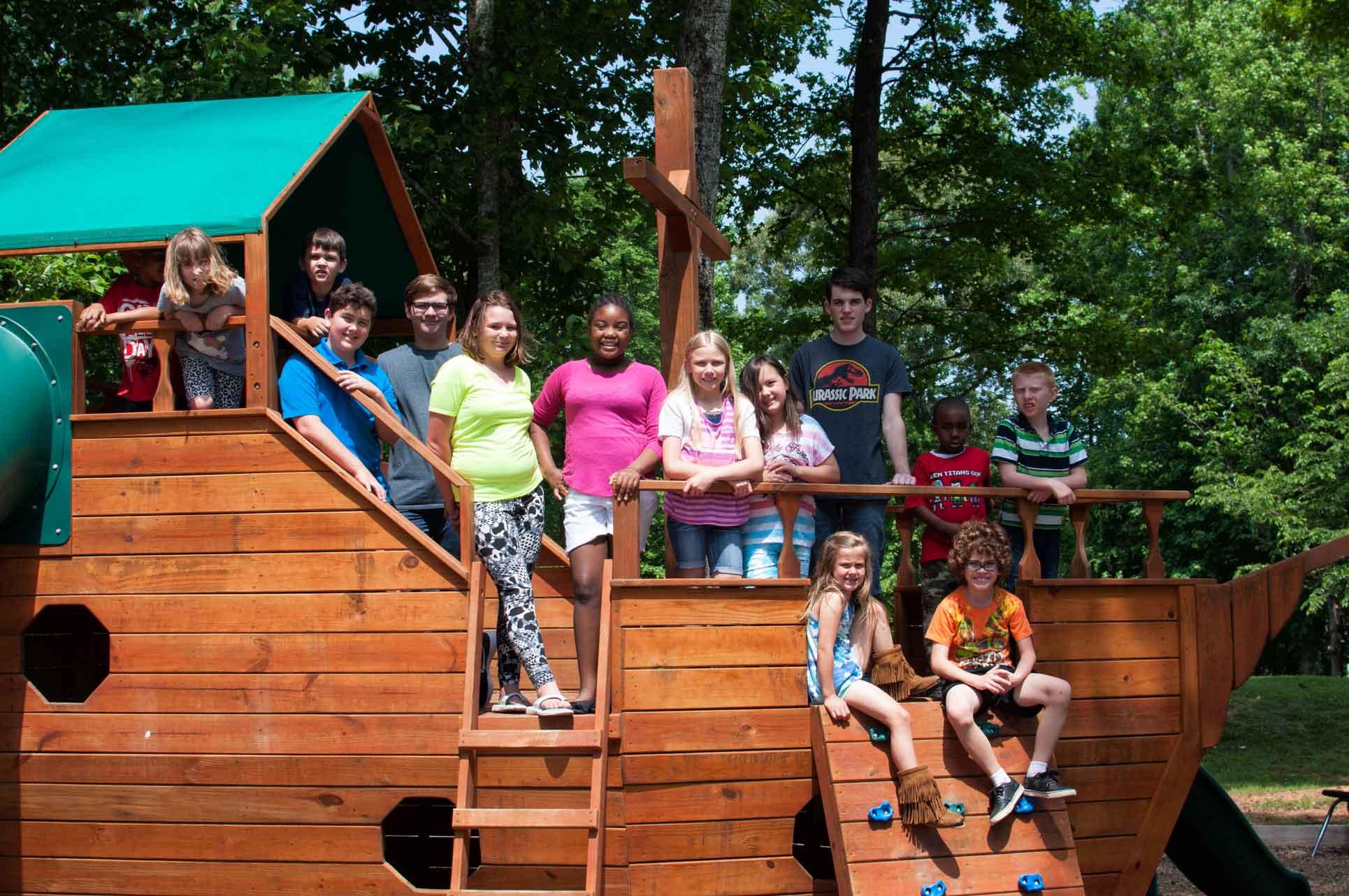 K-12-Students-Sitting-on-Playground-near-Burlington-and-Greensboro-NC