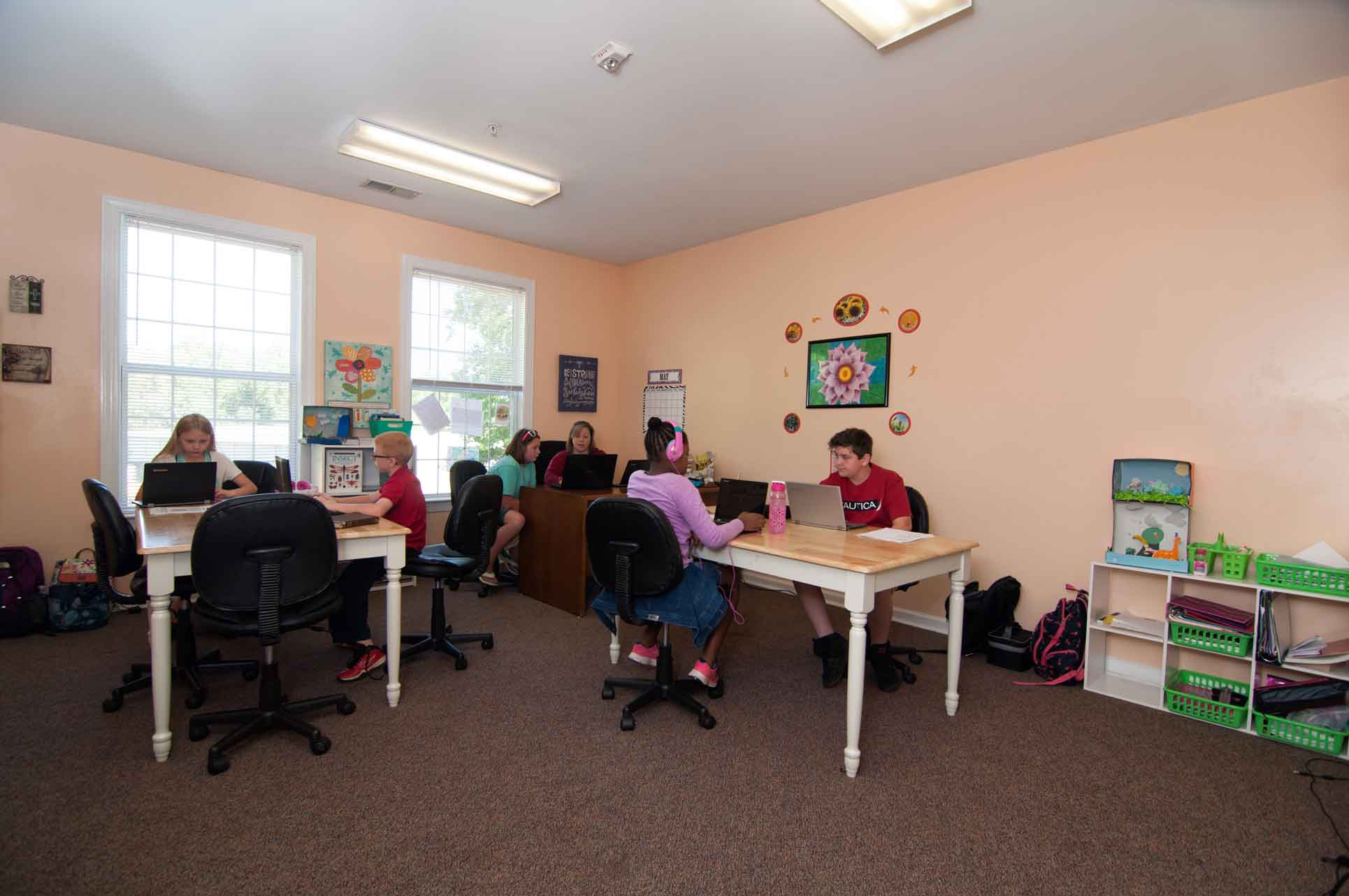 Private-Christian-Elementary-School-Students-Working-on-Computers-with-Teacher