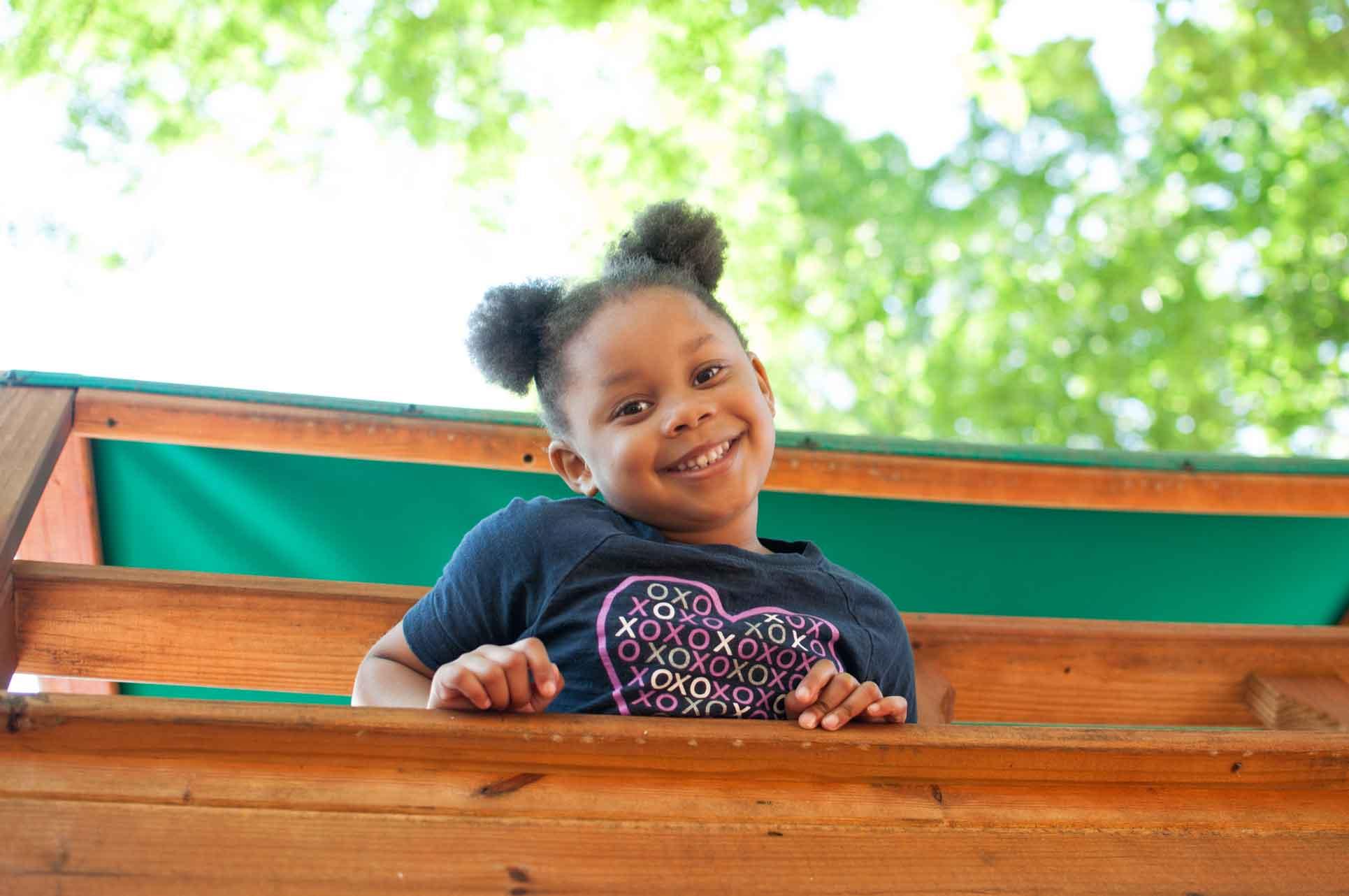 Private-Christian-School-Kindergarten-Student-Smiling-on-Playground-Faith-Christian-Academy-Located-Between-Burlington-and-Greensboro-NC