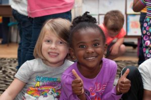 Private Christian Kindergarten Students Giving Thumbs Up Near Burlington and Greensboro NC
