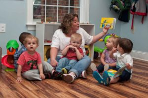 Private Christian Preschool Students Reading Book